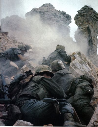 February 1968. Marines scale a mound of rubble as they fight their way into the NVA stronghold in the Citadel – the ancient Imperial capital's fortress – during the battle for Hue.