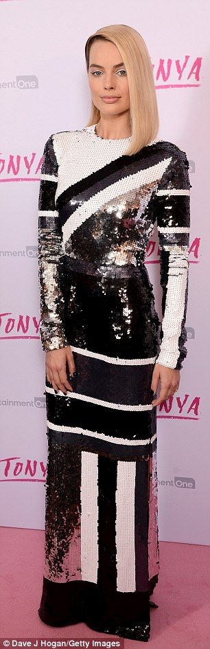A dramatic look: The Australian blonde looked the epitome of sleek in the dress, which cov...