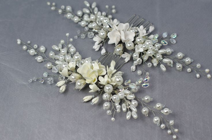I offer an exclusive bridal hair comb as an accessory for beautiful bride. This bridal hair piece is delicate and refined. Handmade pearl wedding comb for hair as jewelry is now in the trend. In the center of the great headpiece handmade sweet flowers are placed from which flexible branches stem with small flowers and buds, pearls of different sizes and shapes, as well as glass crystals. Stunning handicraft bridal comb will decorate any brides hairstyle and looks good on both dark and fair…