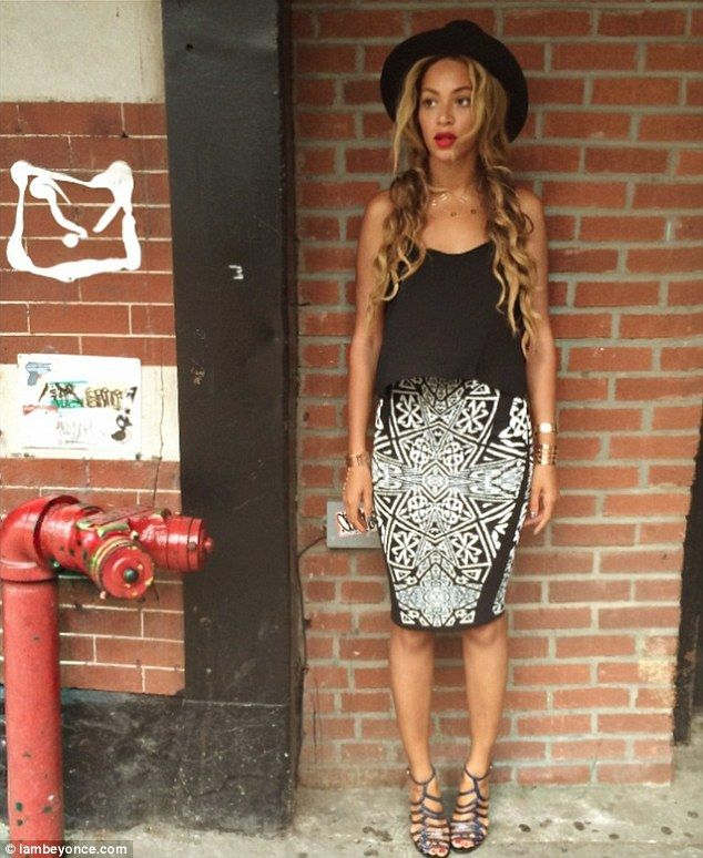 Picture-perfect: This soft-focus image shows the Grammy-winner gazing off to the side as she stands against a brick wall, looking stylish in...