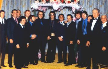 THE MEMPHIS MAFIA: Elvis and Vernon Presley, Charlie Hodge, Red and Sonny West, Marty Lacker, Lamar Fike, George Klein, Joe Esposito, Jerry Schilling, Sam Thompson, Dick Grob and Georges Nichopolous (Dr. Nick).