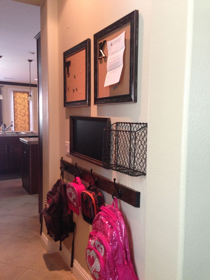My kids' backpack center is finally complete. Their backpacks and lunch boxes hang below. There's a basket to put their school folder in. A magnetic chalkboard that will be used to display extra chores around the house to earn money and they each have a cork board for school info and sports schedules.
