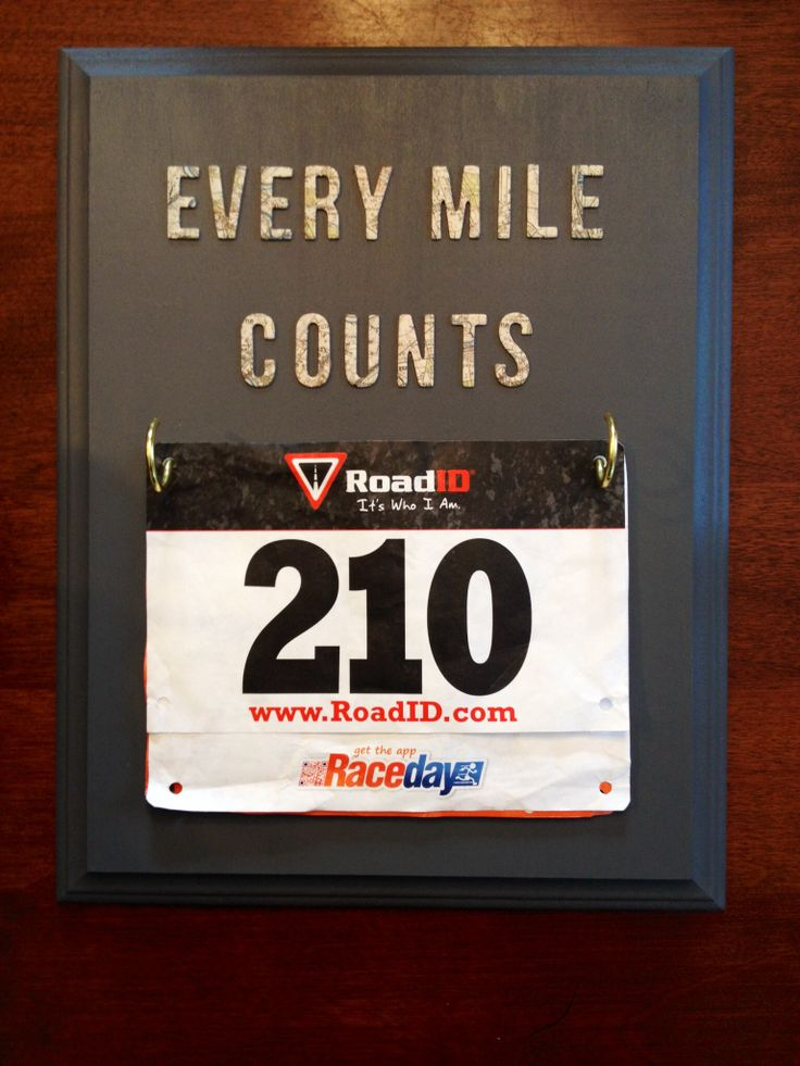 Race bib display using a wooden 11x14 plaque, acrylic paint, cup hooks, and scrapbook lettering (all from Michaels) #diy #gift #craft