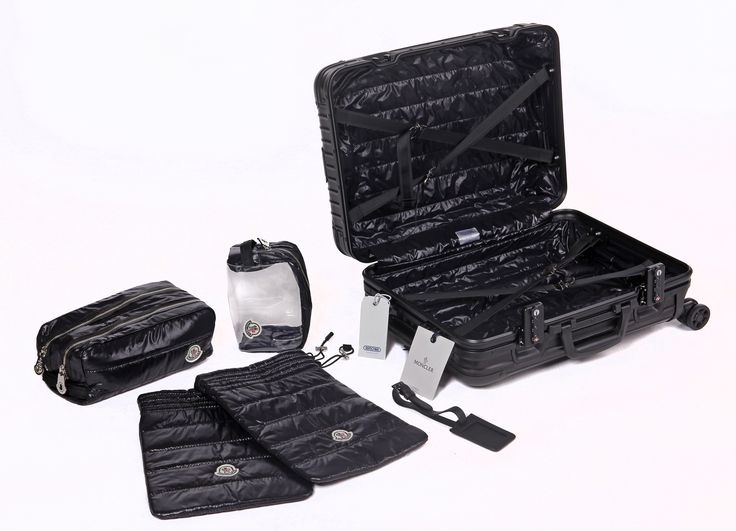 moncler and rimowa present them topas stealth suitcase