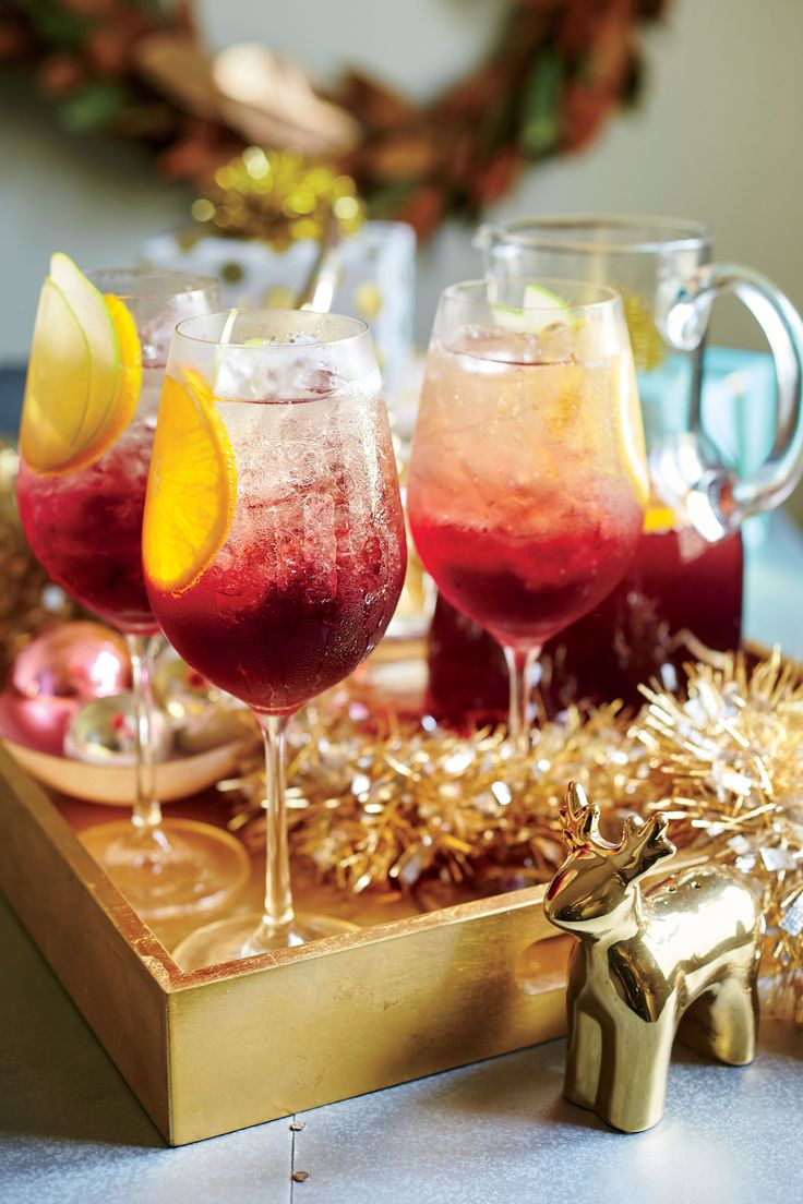 This wintry, ruby-red spin on sangria is a staff favorite but comes with a warning: It goes down easy. You can make it a day ahead to make your life that much easier, and just add the Champagne right before serving. Cheers to your new favorite drink for a crowd! Even though cranberries are usually reserved for holidays, you'll be very tempted to make this punch all year long (we won't judge!). This fruity drink has a beautiful ruby red color, so it's a picture-perfect addition to any holiday…