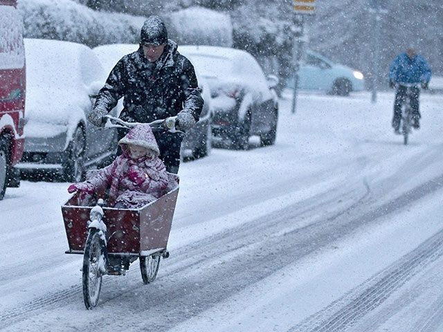 The Dutch bicycle in any type of weather condition.