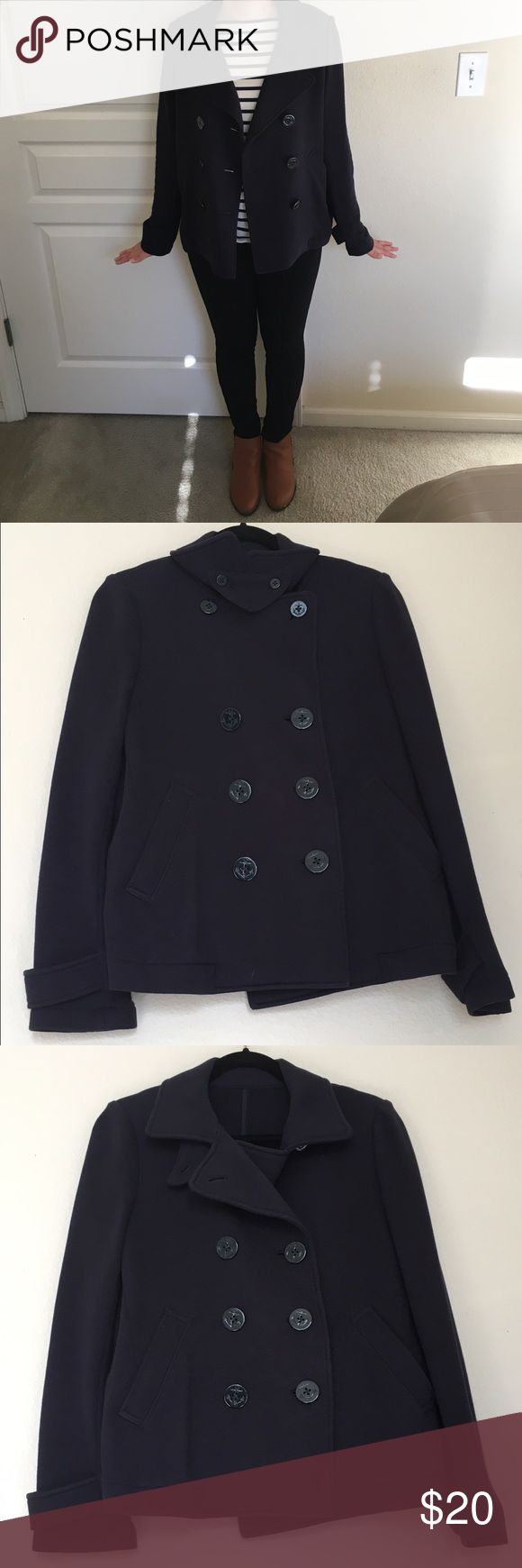 """Uniqlo Japan Navy Coat Navy pea coat from Uniqlo Japan. Light jacket for early spring or fall. The size is a large, but runs more like a medium. 100% cotton. Two ways you can button the coat, and the buttons have an anchor detail. ⚓️I'm wearing the coat in the picture, and I'm 5'3"""". Offers are welcome :)) Uniqlo Jackets & Coats Pea Coats"""