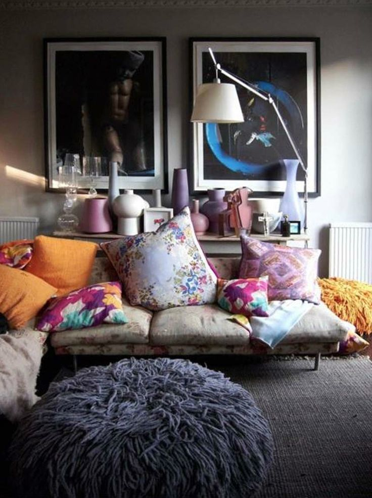 I love the soft furnishings here. muted neutrals with pop of colour and the large wall art