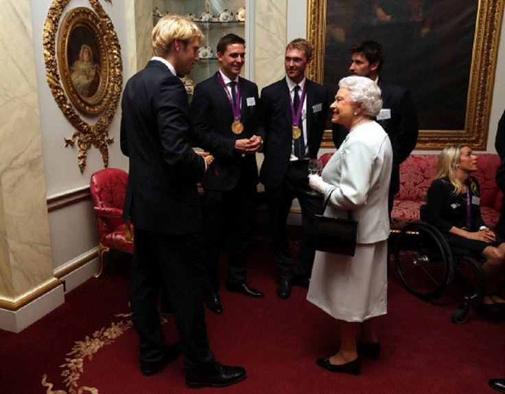 Oct 23 - Queen Elizabeth II meets rowers Andrew Triggs-Hodge, Pete Reed, Alex Gregory and Tom James during a reception for the Team GB Olympic & Paralympic medalists at Buckingham Palace