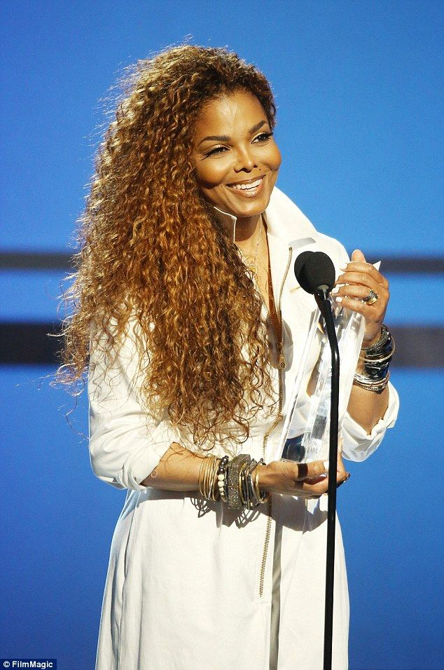 White hot! The singer grinned as she received the Ultimate Icon Award at the BET Awards in...