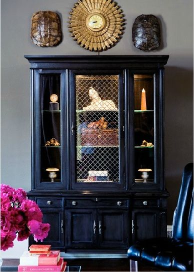 I sold mine, but I had thought to paint it~ like the one at Ethan Allen (soft gray, hinges and all) and store books and shells on the shelf.  So if you don't have a dinning room you can take that formal china cabinet, paint it, and decorate w/artifacts instead of china!