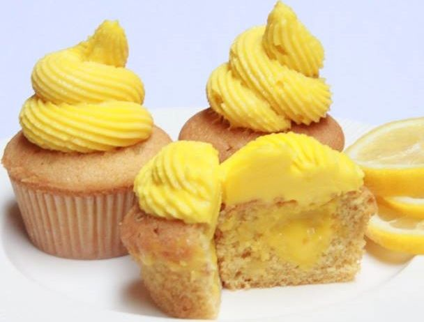 FAITH FAIRIES LEMON MINI CUPCAKE Lip-smacking vanilla cupcake filled with lemon curd and topped with yummy yellow buttercream frosting. (Cupcake vanilla yang nikmat diisi dengan lemon curd yang menyegarkan dan ditutupi dengan buttercream kuning yang nikmat.)