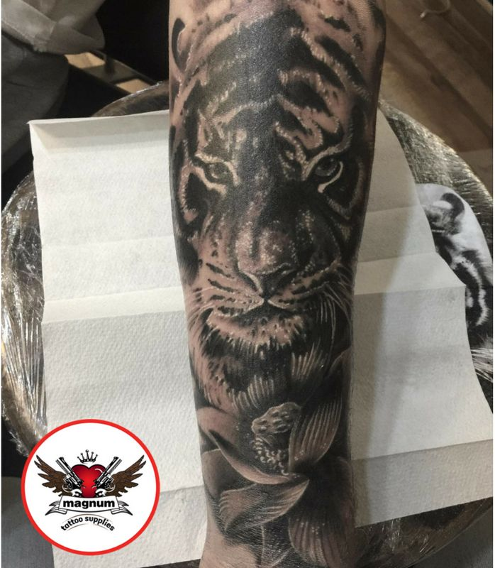 Sick tiger and lotus created with #magnumtattoosupplies 👊👊👊 by Mike C Davies Tattooer