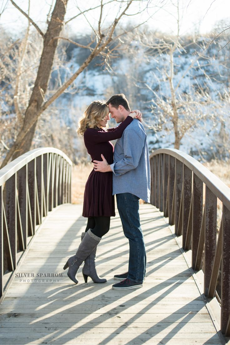 Colorado winter engagement i am in lover with her heeled riding boots and burgandy dress