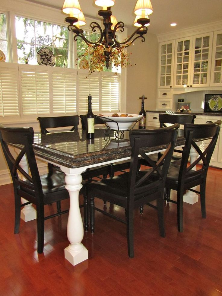 Granite Top Table With White Base, Black Chairs