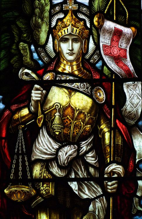 Saint Michael the Archangel. This looks like one of the windows in the church I went to as a child.