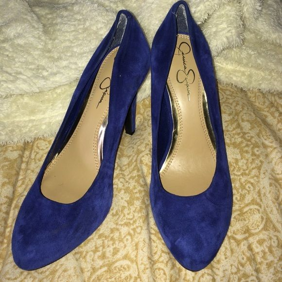 Blue suede Jessica Simpson pumps with 4 inch heel Blue suede pumps with a 4 inch heel. Worn once. Only damage is some wear on inside heels of shoes (see pic) and a black mark on one shoe that you can't really see (see pic) from storage. No size on them but I think they're a 7. No trades thanks! Jessica Simpson Shoes Heels