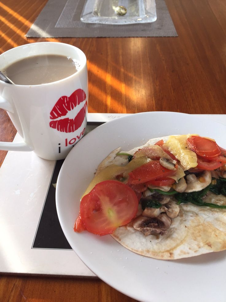 Breakfast! Thin small wrap, mushrooms, spinach leaves tomatoes and slice to cheese. Finally a nice cup of coffee with trim milk.