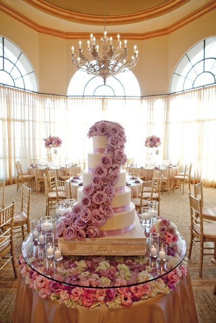Love the additional floral placement under the clear glass..