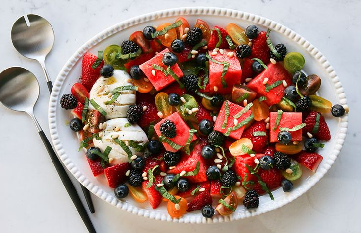 Sweet watermelon, vine-ripened tomatoes and juicy strawberries, melt-in-your-mouth burrata, sprinkled with fresh herbs & pine nuts. This salad is delicious.