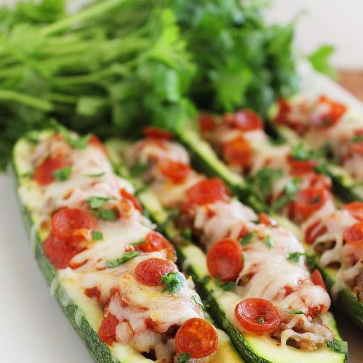 Pizza Zucchini Boats Recipe with zucchini, italian sausage, marinara sauce, shredded mozzarella cheese, pepperoni, fresh parsley