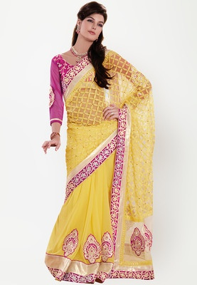 Yellow coloured saree for women by Bahubali. Made from net, this embellished saree measures 5.5 metres and comes with a blouse piece measuring 0.9 metres.