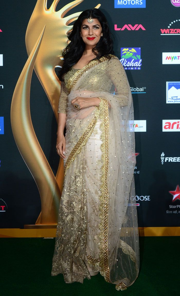 The Lunchbox actress Nimrat Kaur was ethereal in a white and gold embellished Vikram Phadnis net sari.