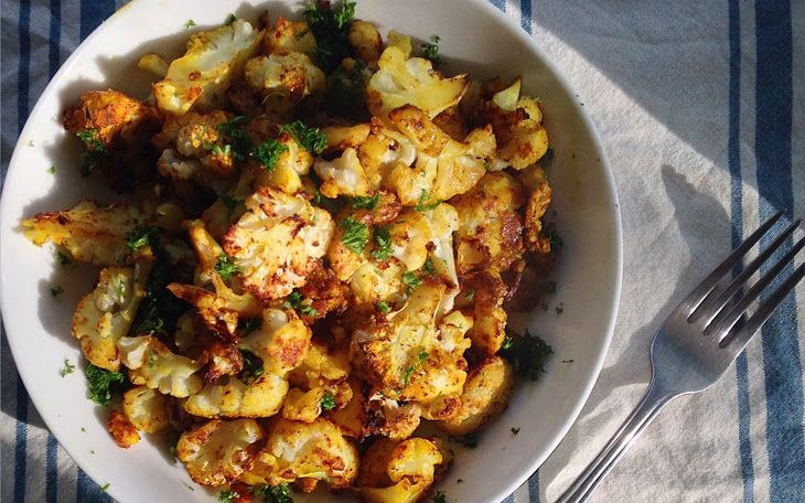 Crispy Seasoned Cauliflower [Vegan] Recipe Main Dishes with cauliflower, potato starch, salt, black pepper, tumeric, nutritional yeast, chili powder, oil