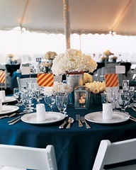 love doing navy table cloths w/ white chairs; love silver buckets with white floral and lots of candles