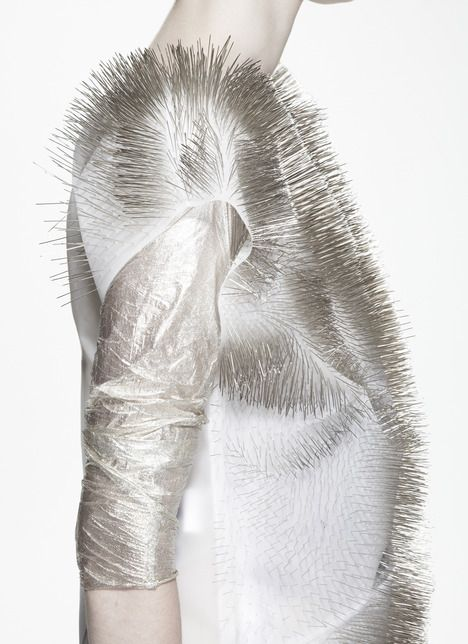Sound Activated Textiles, sense and move with changes in environmental sound. Made from PVFD plastic, pins, and underlying electronics.