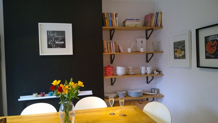 bring depth to your kitchen with a black chalkboard wall and some shelves
