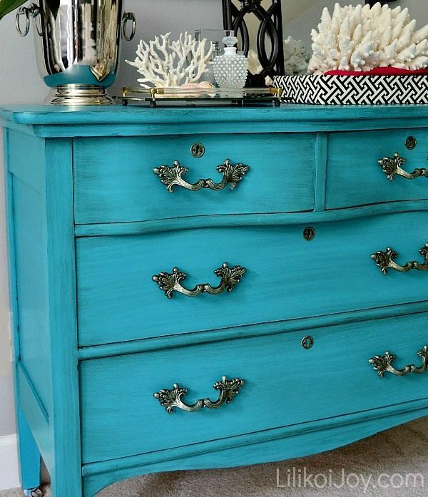 This blue is beautiful. I usually don't like painted dressers, but this one looks good with the metal accents.