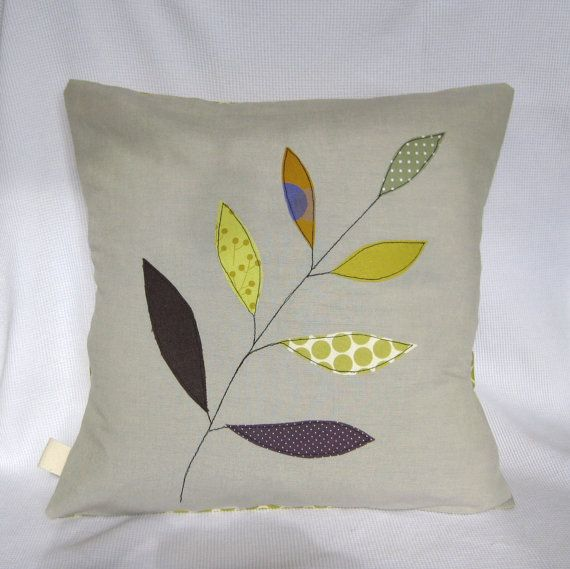 Cushion cover olive green leaves on a branch free by tailorbirds