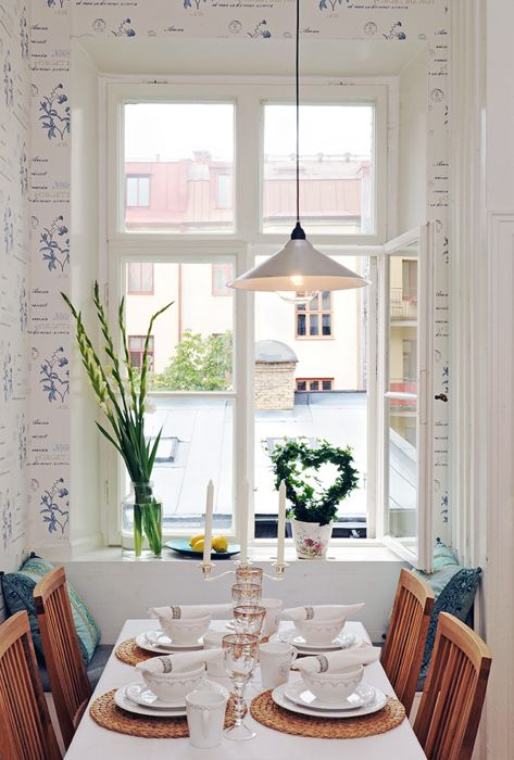 A beautiful dining room somewhere in Sweden. Great window and wallpaper. I  love Swedish
