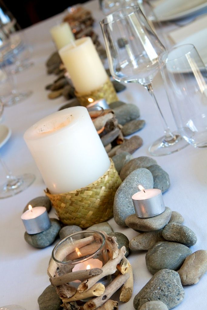 Rustic river: stones, tealights and flax weave detail on candles ...see more on www.facebook.com/tabledecorNZ
