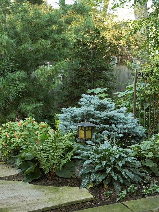 Carved out in a corner, a garden showcases fuss-free plants and trees: http://www.bhg.com/gardening/landscaping-projects/landscape-basics/front-yard-landscaping-ideas/?socsrc=bhgpin030914littlenookinthewoods&page=5