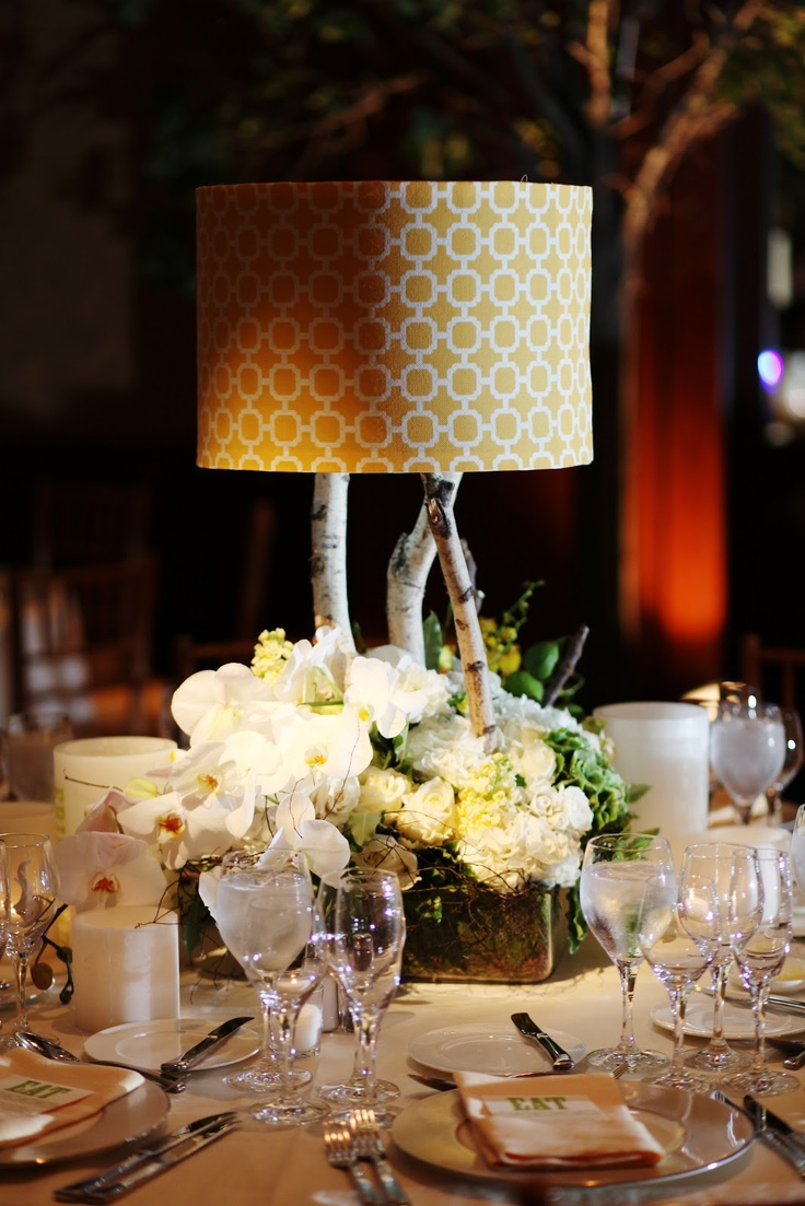 We combined rich textural arrangements with surprising earthy floral touches like figs and clematis as well as introduced unexpected elements like birch table lamps with yellow lattice lampshades. Jenna Walker Photography.
