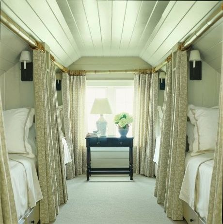 Convert attic in to a family sized guest bedroom. The curtains add privacy just like on a sleeper car of a train.how amazing!!!!