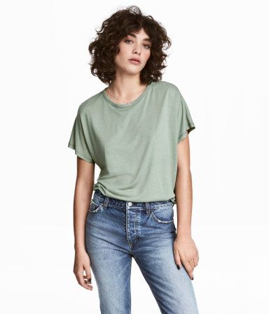 Dusky green. Wide-cut top in soft, crêped viscose jersey with cap sleeves and a gently rounded hem.