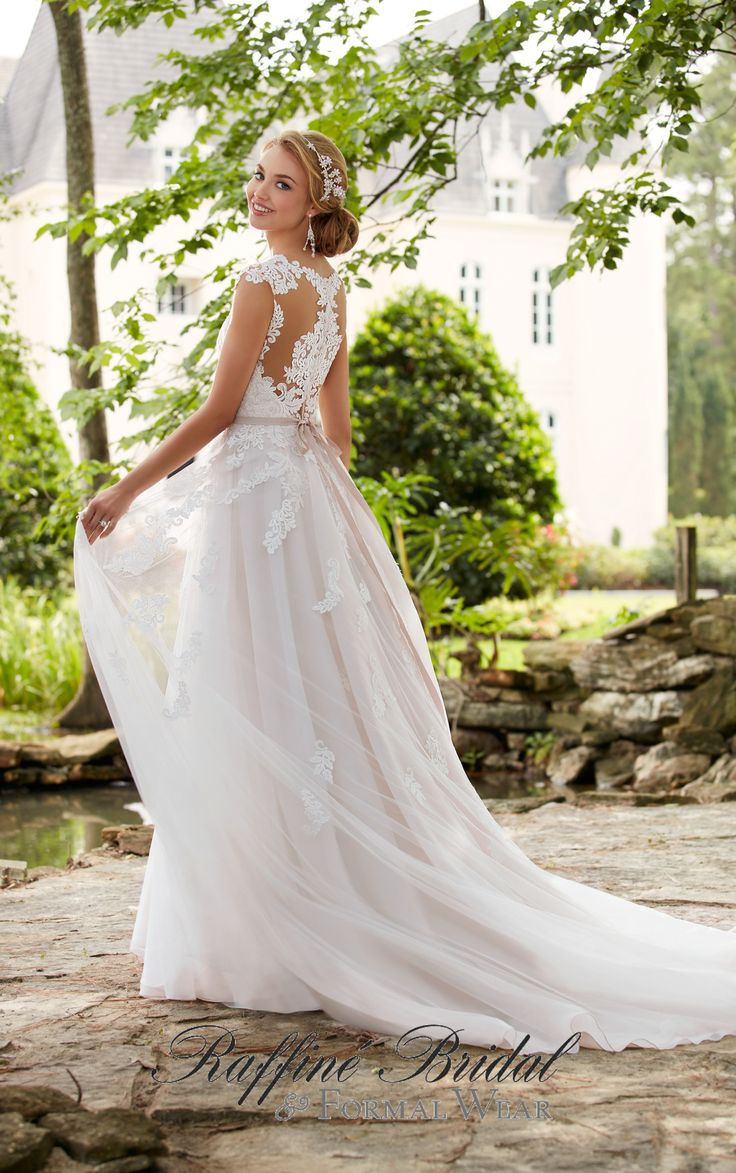 Stella York #6391 - This romantic cap sleeve wedding dress with cameo back from Stella York flatters all figures with it's natural waist belt, and sweetheart neckline.