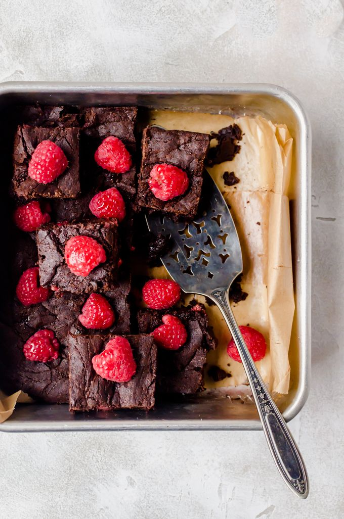 The fudgiest raspberry brownies you will ever meet. The perfect late night treat to have when you need to indulge. Perfect with a glass of wine.