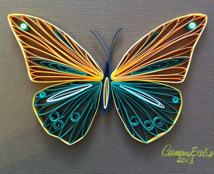 Quilled butterfly with bright colors.