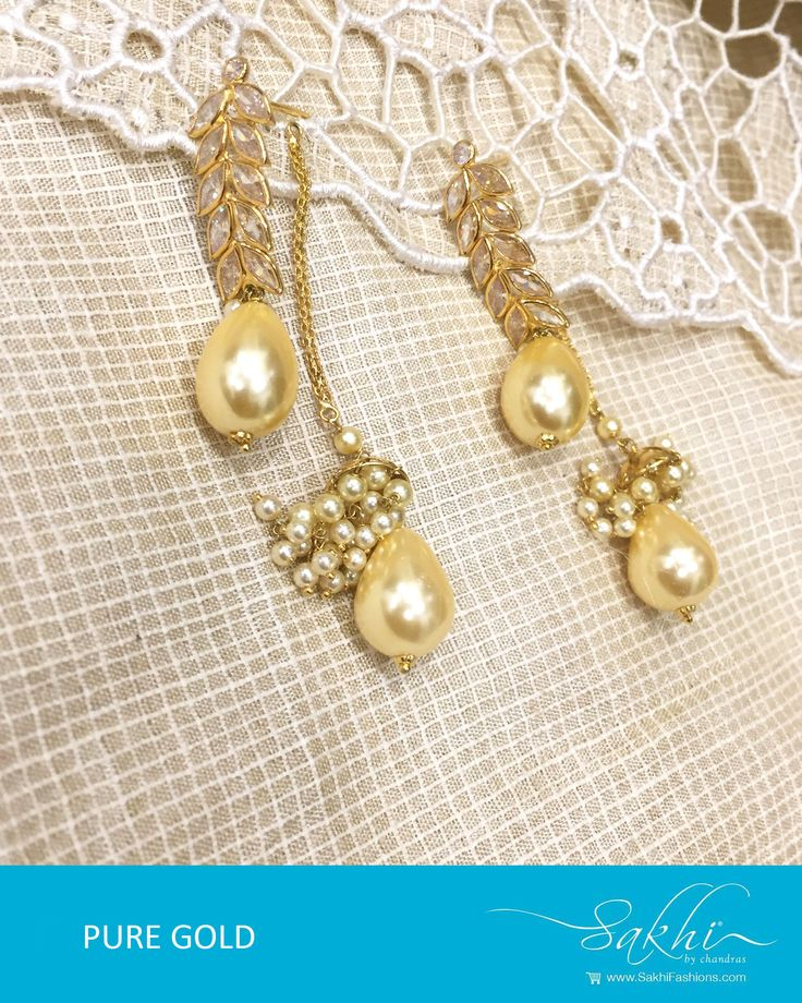 Look stunning in this Gold & White Pure Gold Jhumka with white pearls design #design #decor #fashion #stunning #gold #dropsdesign #pearl