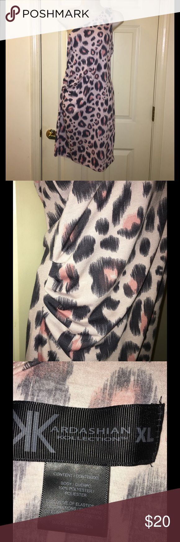 XL Pink Animal Print Dress Kardashian Kollection Pink animal print dress.  Bodycon style with side rucked waist.  One shoulder. Size XL. Kardashian Kollection.  Great condition.  Important:   All items are freshly laundered as applicable prior to shipping (new items and shoes excluded).  Not all my items are from pet/smoke free homes.  Price is reduced to reflect this!   Thank you for looking! Kardashian Kollection Dresses One Shoulder