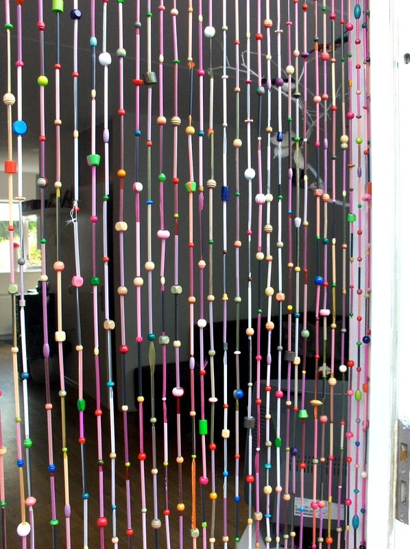 curtain of beads and ribbon