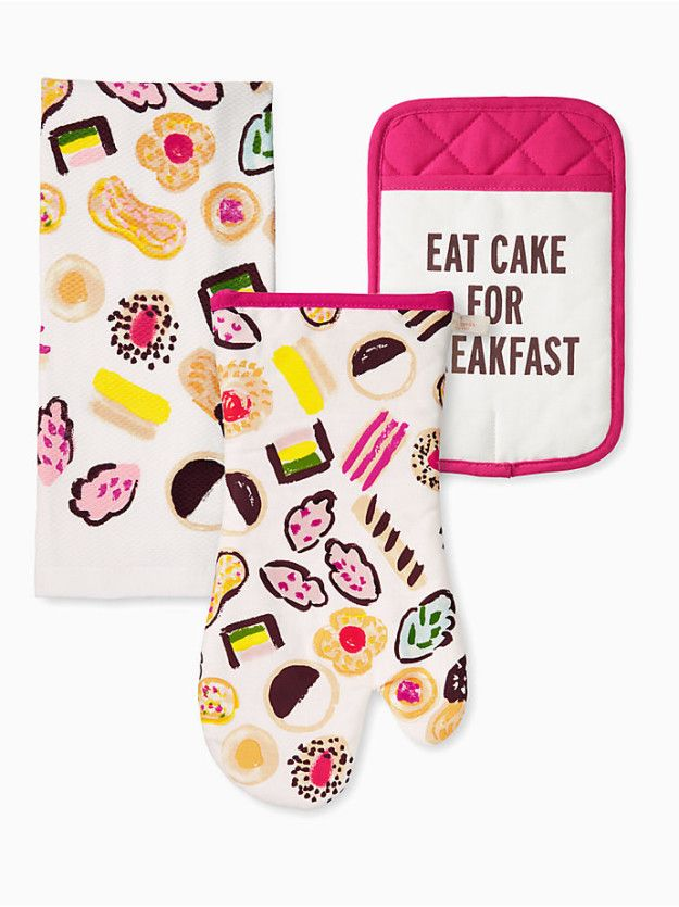 A set from Kate Spade featuring a beautifully illustrated tea towel and oven mitt, plus a pot holder that knows that cake isn't *only* suitable for dessert. | 31 Gifts For People Who Would Totally Eat Cake For Every Meal