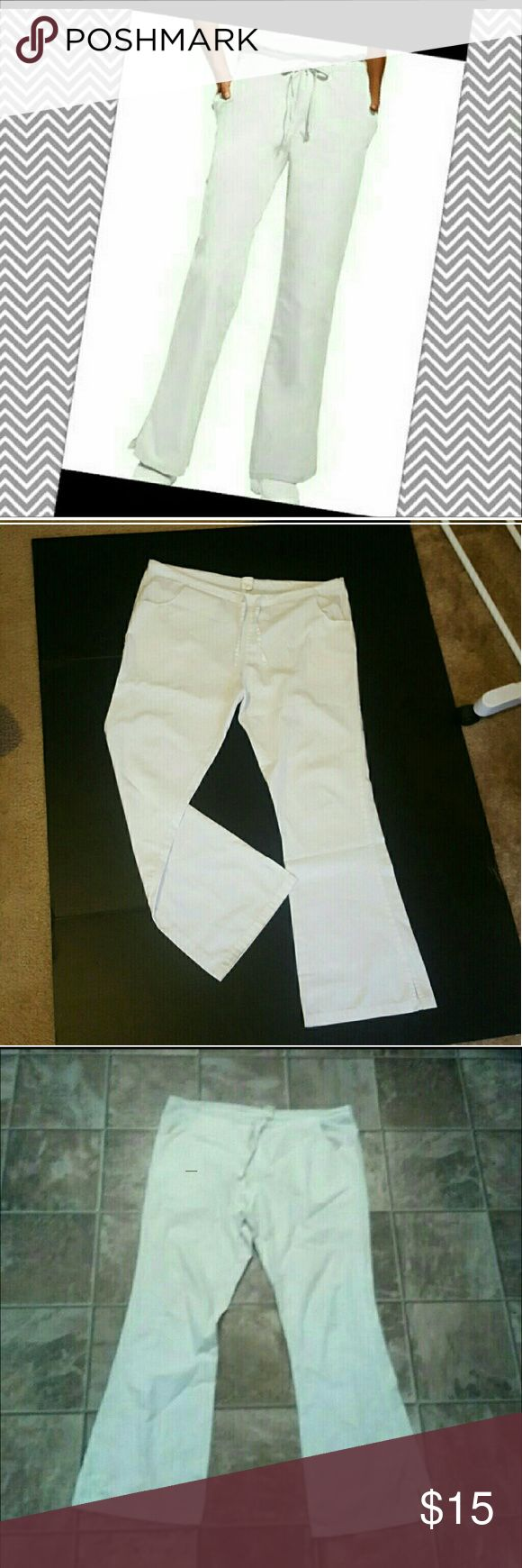 """White Dickies Scrub Pants Flare Nurse Uniform Med White Dickies Scrub Pants, size Medium, in great condition. Laying flat, they measure 19"""" across the waist, 39.5"""" long, 29"""" inseam.  They tie at the waist & have pockets.  Smoke free home. I will gladly bundle items to give you a discount (the more you buy, the cheaper I can let everything go!). Many items can be added on for only $1. Dickies Pants Boot Cut & Flare"""