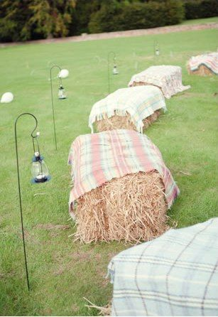 Alternative Seating | Hay bales covered with plaid blankets (Use my Christmas party plaid blankets, on Hay bales around the bonfire.