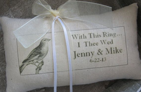Romantic petite wedding pillow...So PERFECT in the hands of your sweet Ring Bearer!    At only 4 x 7, this charming little ring pillow makes a big impact. Sweet vintage french bird is perched next to your names and wedding date under the words With This Ring I Thee Wed.    Ribbon Selections:    1. Warm Ivory Organza / Ivory Satin Ring Ribbon  2. French Black Organza / Black Satin Ring Ribbon  3. Pink Organza / Pink Satin Ring Ribbon     A vintage key charm is attached to the back label for…