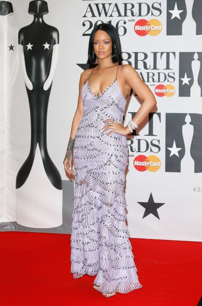 Rihanna Photos - Rihanna attends the BRIT Awards 2016 at The O2 Arena on February 24, 2016 in London, England. - Brit Awards 2016 - Red Carpet Arrivals